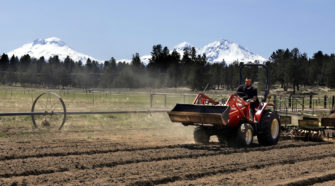 FILE – In this April 23, 2018, file photo, Trevor Eubanks, plant manager for Big Top Farms, readies a field for another hemp crop near Sisters, Ore. Draft rules released by the U.S. Department of Agriculture for a new and booming agricultural hemp industry have alarmed farmers, processors and retailers across the country, who say the provisions will be crippling if they are not significantly overhauled before they become final. (AP Photo/Don Ryan, File)